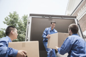 movers unloading moving boxes from a moving truck
