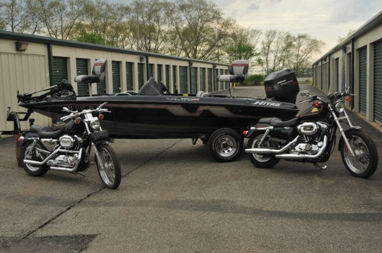 Motorcycles And Boat At Self Storage Facility